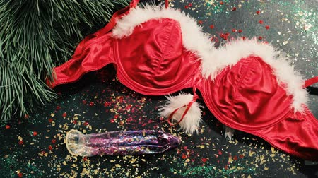 prezerwatywa : Part of Christmas womans mascot costume with used condom, top view. Winter holidays and adult celebration concept Wideo