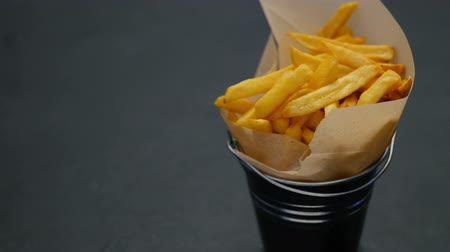 unbalanced : french fries serving. fast food fattening diet. unbalanced nutrition. chips fall from above