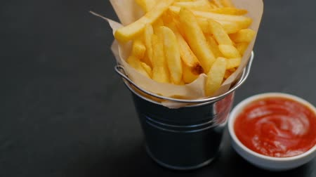 brambory : fast food. french fries serving and ketchup. tomato sauce. fatty meal