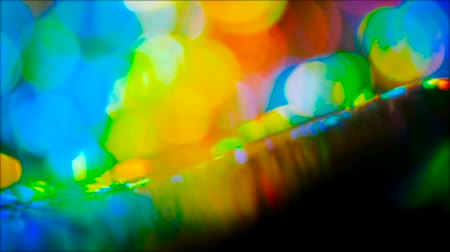 speck : Defocused colorful lens flare. Bokeh multicolor circle lights reflection. Flowing glow effect.
