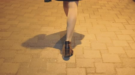 上流階級の : Young pretty lady enjoying time alone with champagne. Girl walking along the street with night city lights.