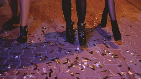 上流階級の : Girls night walk. City street covered with golden confetti left after open air party. Luxury celebration. 動画素材