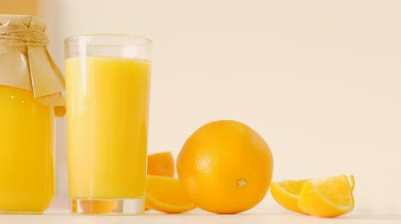 presleme : Slider shot of orange fresh glass bottle juice. Healthy nutrition fitness cleanse products. Vegan dieting breakfast eating habit.