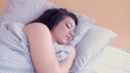 deep eyes : Relaxing morning. Young brunette lady sleeping in comfortable bed, having rest, enjoying dreams.