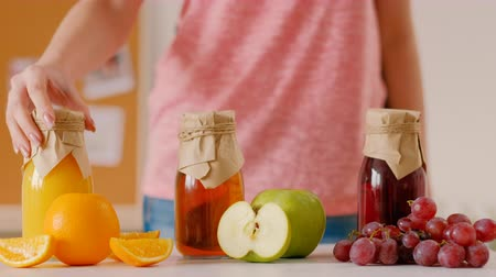 balanced : Balanced nutrition. Organic fresh fruit. Woman choosing homemade juice for breakfast. Natural vitamin drink assortment. Stock Footage