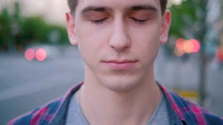 relance : Awakening liberty and insight. Closeup portrait of young man opening eyes. Vídeos