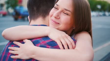 intimita : Love and relationship. Happy meeting. Young couple hugging in the street. Dostupné videozáznamy