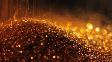 kıymetli : Gold glittering particles pouring down. Precious metal wealth and lux. Stok Video