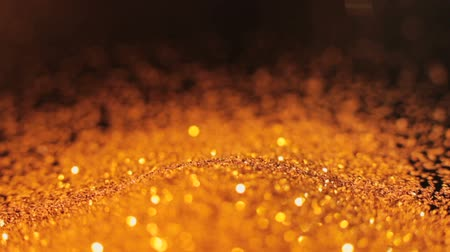 lux : Gold glitter falling down. Shiny glistening bokeh decor. Stock Footage