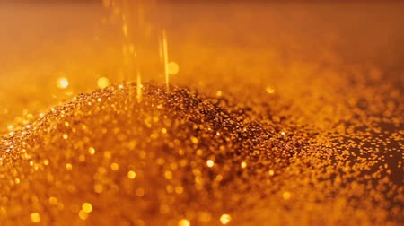 lux : Gold glitter sprinking down. Shiny glistening defocused particles motion Stock Footage