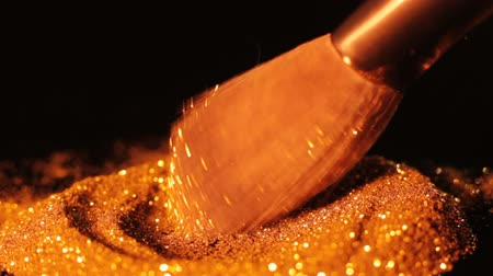 obsession : Fashion and gold obsession. Shiny glitter dab on makeup brush.
