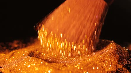 obsession : Luxury glamour and makeup trends. Gold glitter particles dab on brush