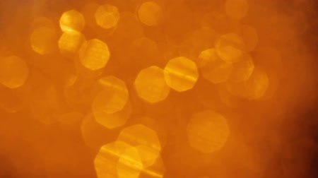 lux : Defocused blurred bokeh. Gold colored lens flare lights. Festive flickering motion Stock Footage