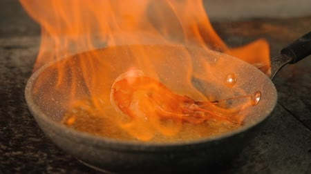 seafood recipe : Chef professional skills. Cook flambering shrimp in pan. Restaurant meal preparing