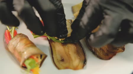 balanced : Vegan food. Vegetarian delicatessen and hors doeuvres. Chef preparing eggplant rolls Stock Footage
