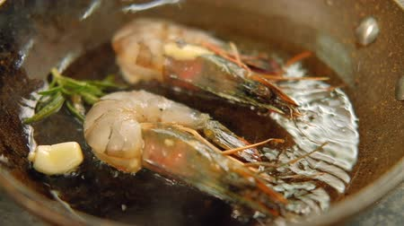 nourishing : Seafood meal cooking. Mediterranian food recipe. Shrimps frying in pan