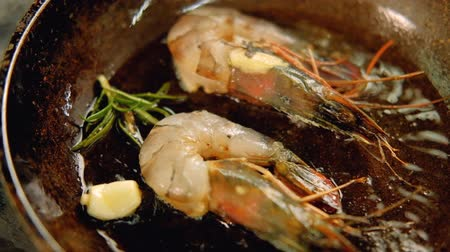 seafood recipe : Seafood meal cooking. Mediterranian food recipe. Shrimps frying in pan