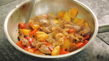 panelas : Stew preparation. Food cooking recipes. Chef stirring fried meat and vegetables in pan