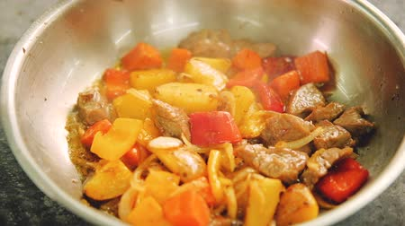 panelas : Stew preparation. Food cooking recipes. Fried meat and vegetables simmering in pan