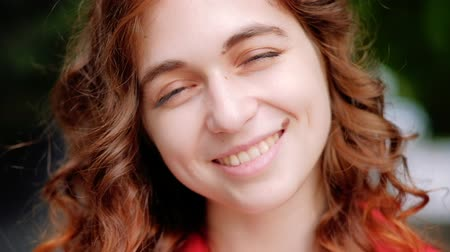 coquettish : Happy smiling joyful young woman. Curly ginger hair cutie with a birthmark. Closeup portrait Stock Footage