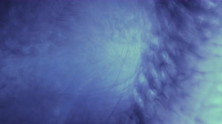 rozptyl : Abstract clouds slow motion. Dark blue inks creating fog effect. Moving lens flare light.