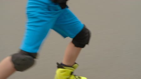 schoolkid : Speed rollerblade hobby. Young confident boy performing trick on the ramp