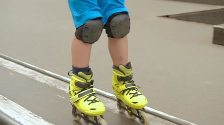 inline : Speed roller skate hobby. Young confident boy performing trick on small ramp Stock Footage