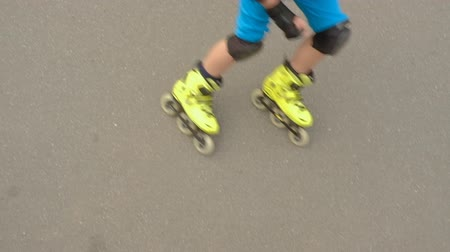 inline : Sporty kids leisure. Boy on roller skate skating asphalt