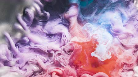 拡散 : Colorful inks explosion underwater. Liquid paints mixing. Abstract smoke flow. 動画素材