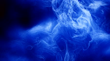 rozptyl : Ink swirling. Flowing blue paints. Spreading clouds of smoke animation effect.