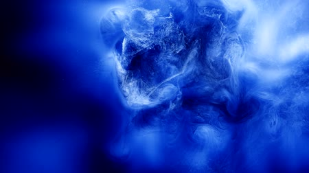 rozptyl : Ink motion in water. Blue paint animation and swirl. Abstract deep space slow motion glow.