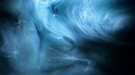 rozptyl : Ink cloud motion. Blue paints in water. Abstract silky fabric animation. Smoke fusion