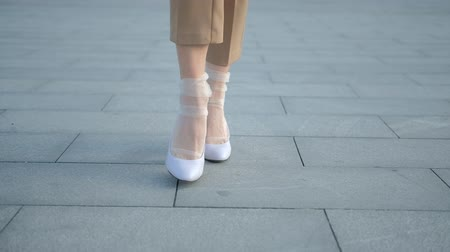 femminismo : Legs walking. Determination and emancipation. Female feet on heels and in trendy nylon socks