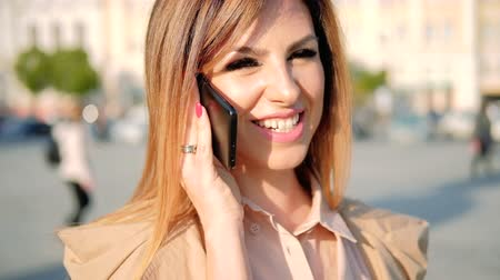 emancipation : Friendly call. Mobile communication. Smiling woman talking on the phone in the street. Stock Footage