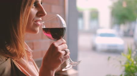 timeout : Relaxing with glass of wine. Woman enjoying alcohol in cafe