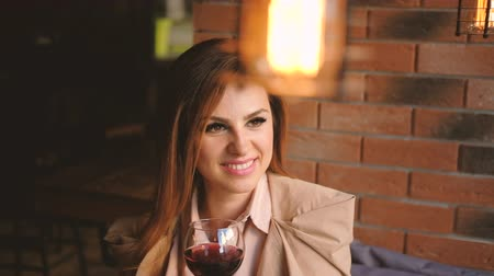 timeout : Relaxed leisure. Woman looking at someone holding a glass of wine