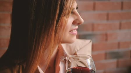 durulması : Relaxing after work. Business woman holding a glass of red wine in cafe