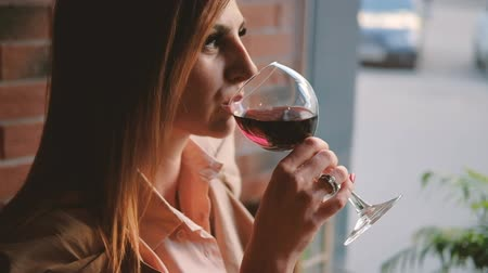 timeout : Relax and unwind. Business woman having a glass of red wine in cafe