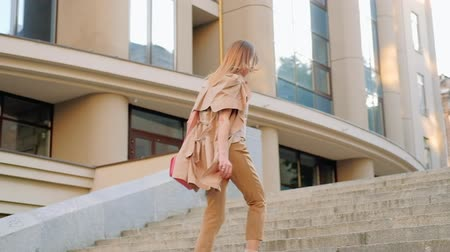 emancipation : Hurried urban lifestyle. Determined stylish woman running up the staircase