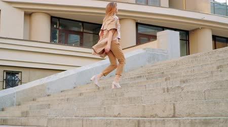 emancipation : Business woman walking up the staircase. City rush. Stylish female in a hurry