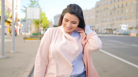 feminism : Carefree mood and loving life. Happy smiling woman with a spring in her step walking in the city sunlight Stock Footage