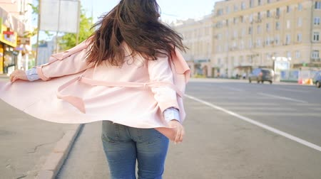 delighted : Carefree happy mood. Joyful excited smiling woman walking and spinning in the street. Stock Footage