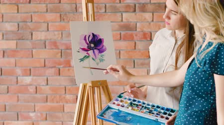 сочетание : Fine arts education. Painter explaining colors and shading on a flower drawing