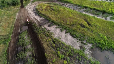 závodní dráha : Motocross hobby. Race drivers circling natural dirty track in cross country. Aerial shot