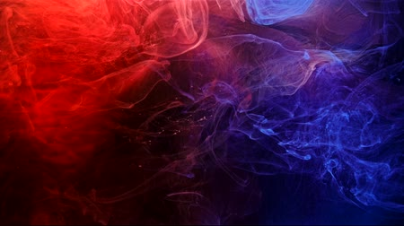 こぼれ : Ink mix. Mysterious alchemy. Red blue colored steam. Abstract fluid motion. 動画素材