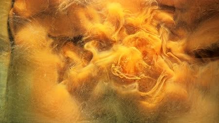 renkli : Ink flow. Magic explosion. Golden colored liquid nitrogen. Yellow acrylic paint motion. Stok Video