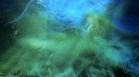 rozptyl : Ink mix. Magic dust. Sage green blue steam flow. Colored glitter paint leak.