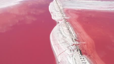застекленный : Water pollution. Red poisoned lake. White toxic foam.