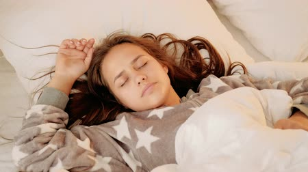 пробуждение : Unwanted awakening. Denying rejection protest. Sleeping teenage girl resisting waking up. Стоковые видеозаписи