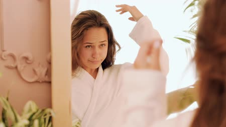 getting ready : Natural female beauty. Health wellness purity. Teenage girl in bathrobe flaunting in mirror.